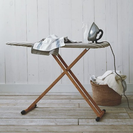Ironing Board With Iron In Room