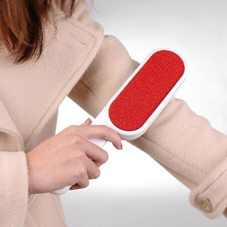 Lint Remover Used On Coat